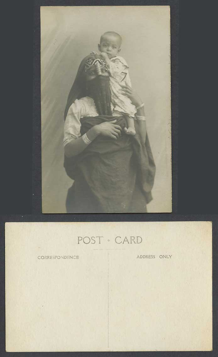 Egypt Old Real Photo Postcard A Native Veiled Egyptian Woman Lady Holding a Baby