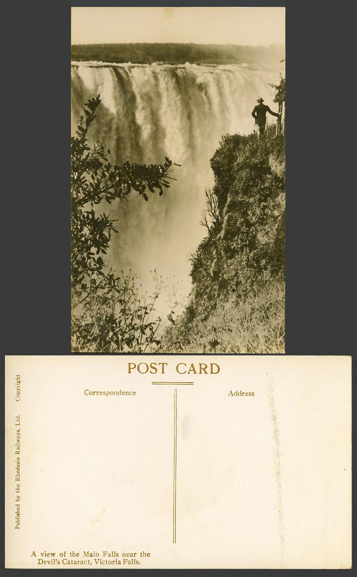 Rhodesia Old Real Photo Postcard VICTORIA MAIN FALLS Devil's Cataract Man stands